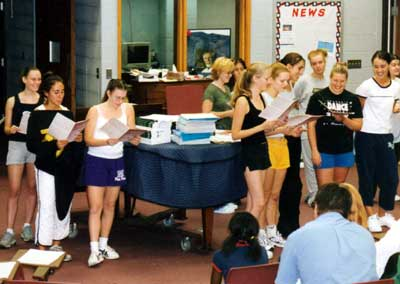 Students sing around the piano at Summer Choir Camp 2002